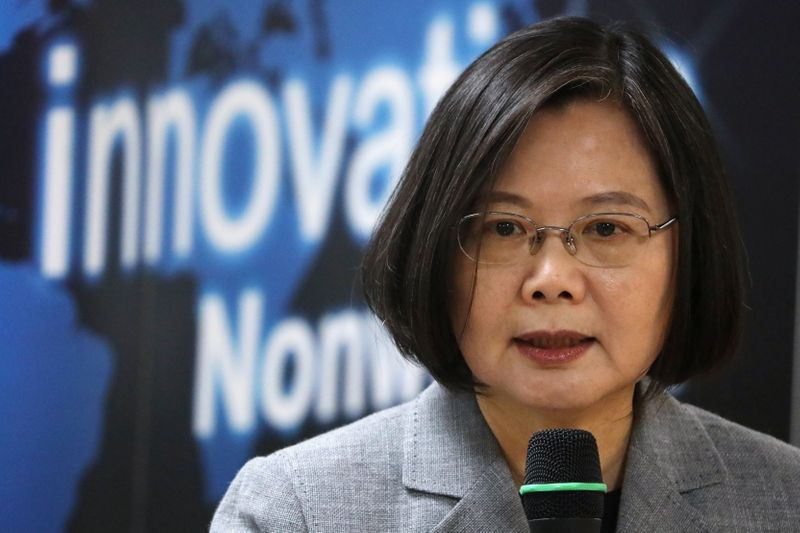 Taiwanese president Tsai Ing-Wen speaks at a non woven filter fabric factory, where the fabric is used to make surgical face masks, in Taoyuan