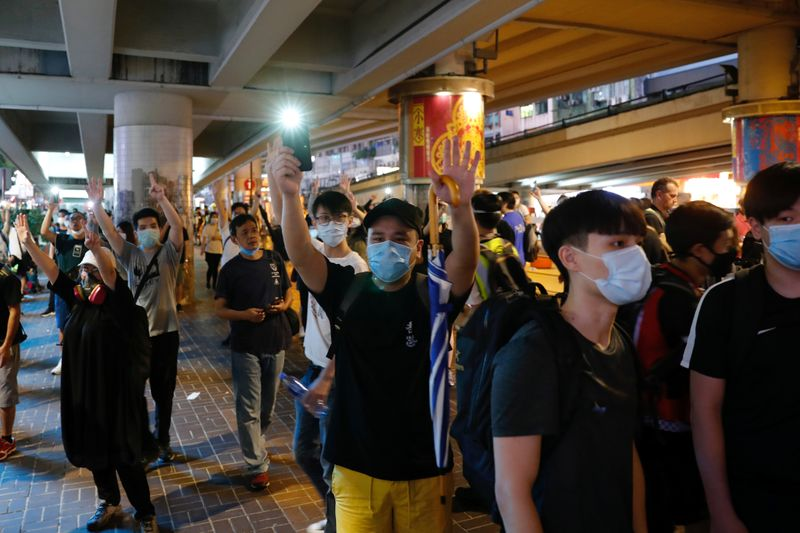 Anti-government protesters march against Beijing's plans to impose national security legislation in Hong Kong