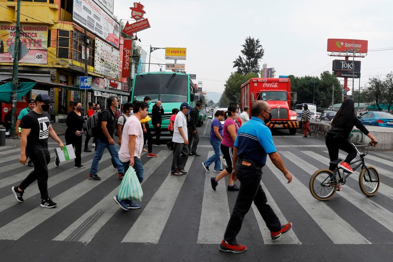 People cross a road in the municipality of Iztapalapa as the outbreak of the coronavirus disease (COVID-19) continues in Mexico City