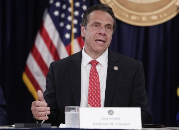 New York's daily virus death toll falls below 100, governor says