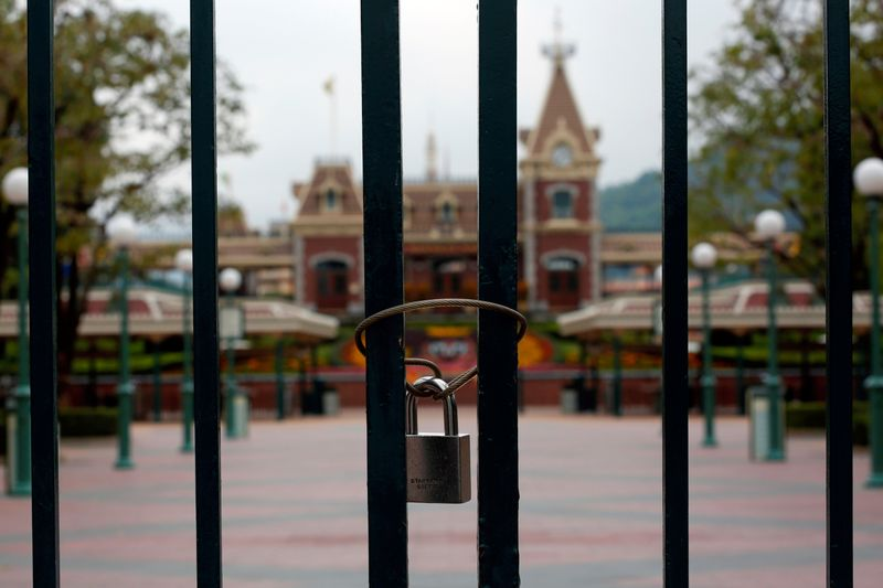 FILE PHOTO: A locked gate is seen after the Hong Kong Disneyland theme park closed due to the coronavirus outbreak
