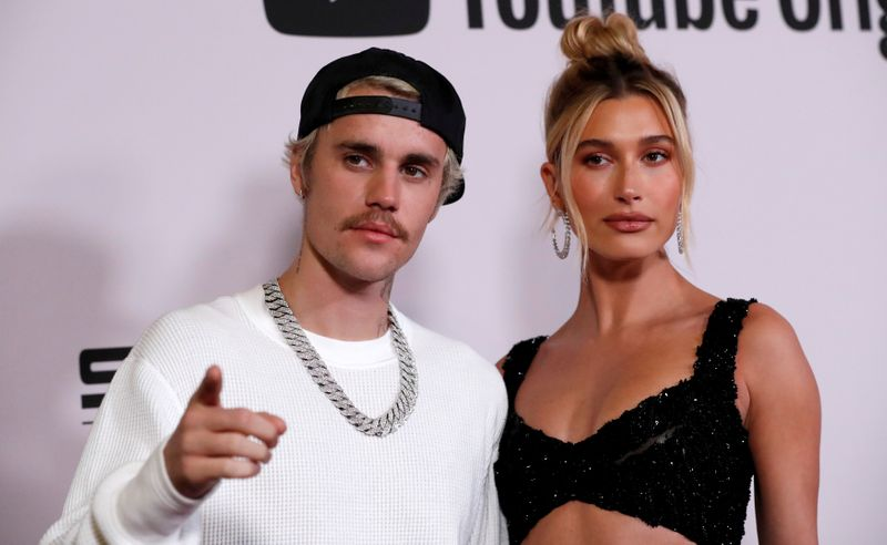 FILE PHOTO: Singer Bieber and his wife Hailey Baldwin pose at the premiere for the documentary television series