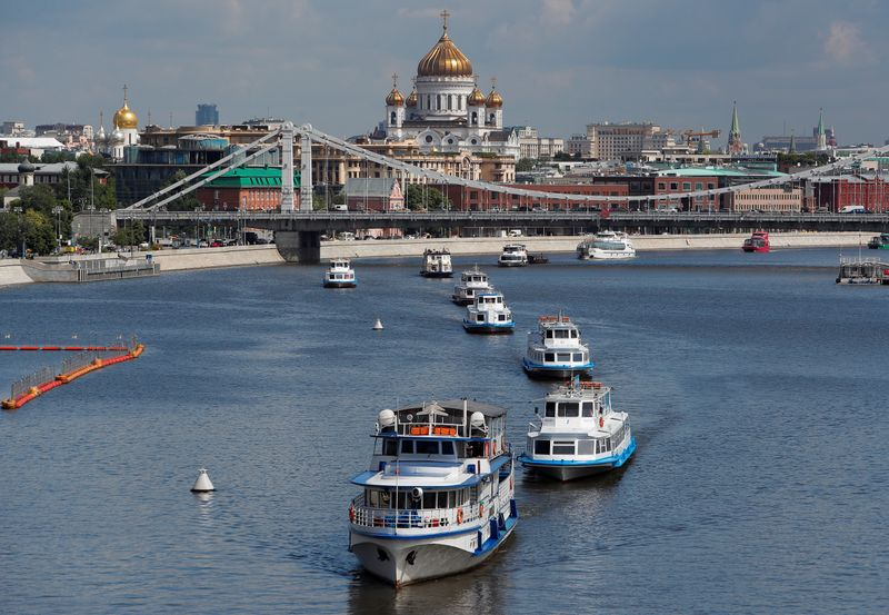 Cruise vessels sail along the Moskva River in Moscow
