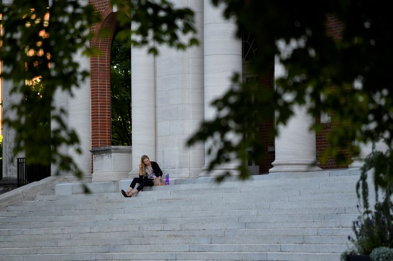 FILE PHOTO: Hannah Carlile, a masters student, relaxes on the steps of the Faye and Joe Wyatt Center for Education on the campus of Peabody College at Vanderbilt University