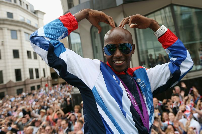 Long distance runner Mo Farah makes his trademark