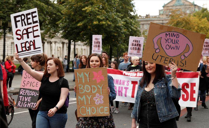 Pro-choice demonstrators take part in a march in Belfast