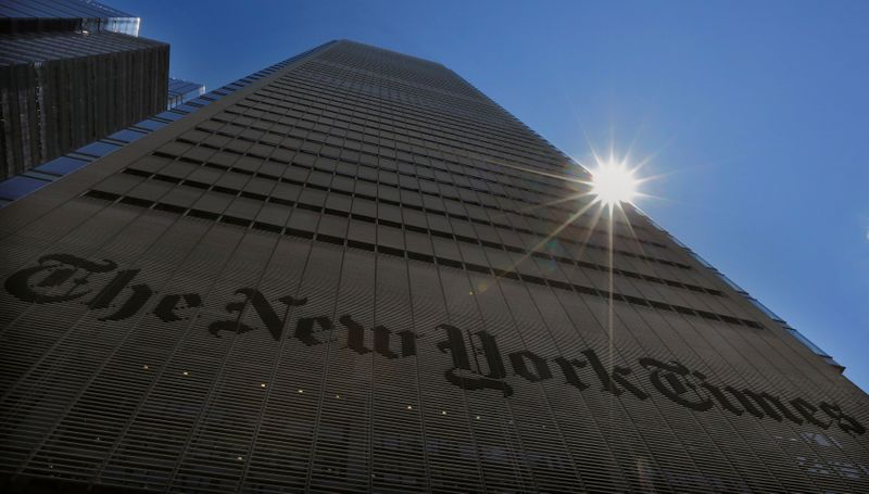 FILE PHOTO: The sun peaks over the New York Times Building in New York