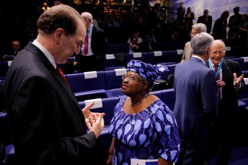 FILE PHOTO: World Bank President David Malpass talks to Ngozi Okonjo-Iweala, former Finance Minister of Nigeria, during a conference entitled