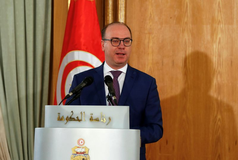 FILE PHOTO: Tunisian Prime Minister Elyes Fakhfakh speaks during a handover ceremony in Tunis