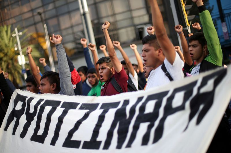 FILE PHOTO: Students participate in a march in Mexico City to mark 65th month since disappearance of the missing Ayotzinapa College Raul Isidro Burgos students in the state of Guerrero