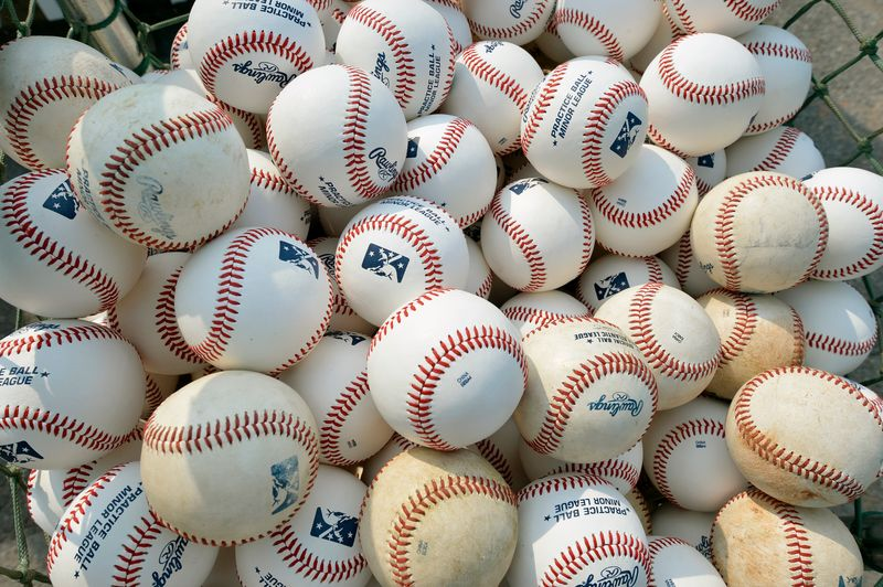 Basket of baseballs are seen during practice at a minor league baseball game in Maryland