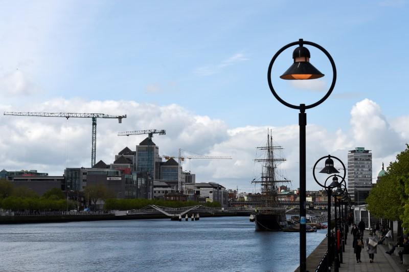 Construction cranes are seen in the Irish Financial Services Centre in Dublin