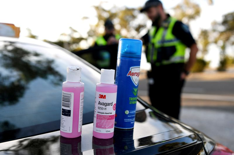 FILE PHOTO: Disinfectant products are seen on a car whilst motorists fill out paperwork for police as they cross back into South Australia from Victoria during the coronavirus disease (COVID-19) outbreak, in Bordertown