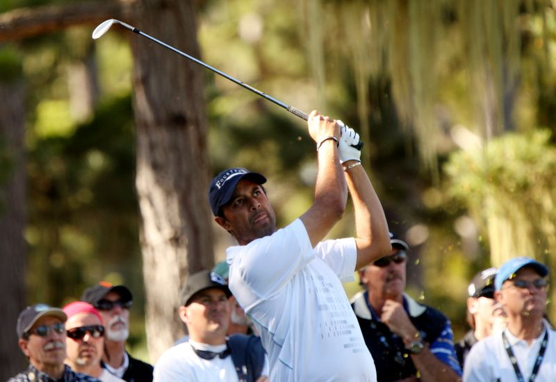 FILE PHOTO:  Atwal tees off on the 15th hole at Spyglass Hill golf course during the first round of the Pebble Beach National Pro-Am