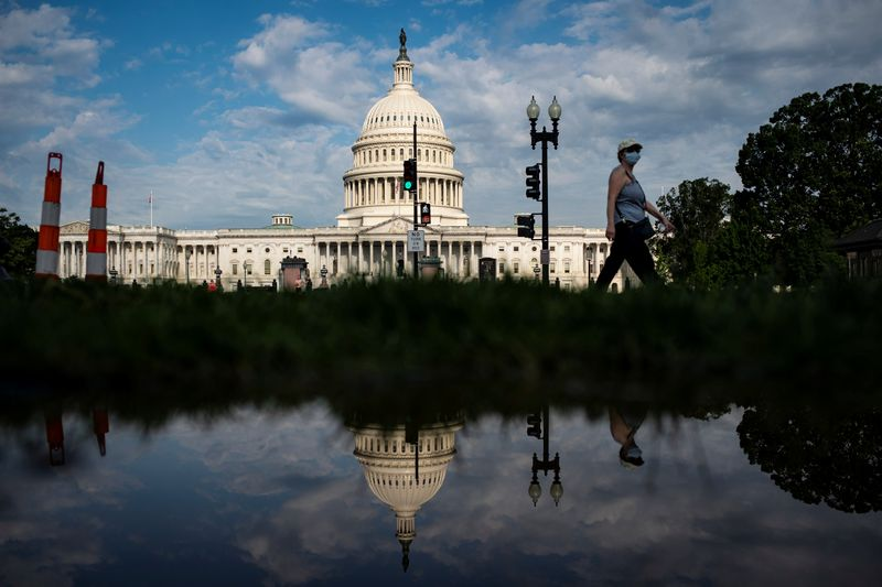 A woman walks past the U.S. Capitol building in Washington
