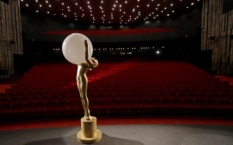 A statue of the Crystal Globe Award is seen inside an empty cinema in Karlovy Vary