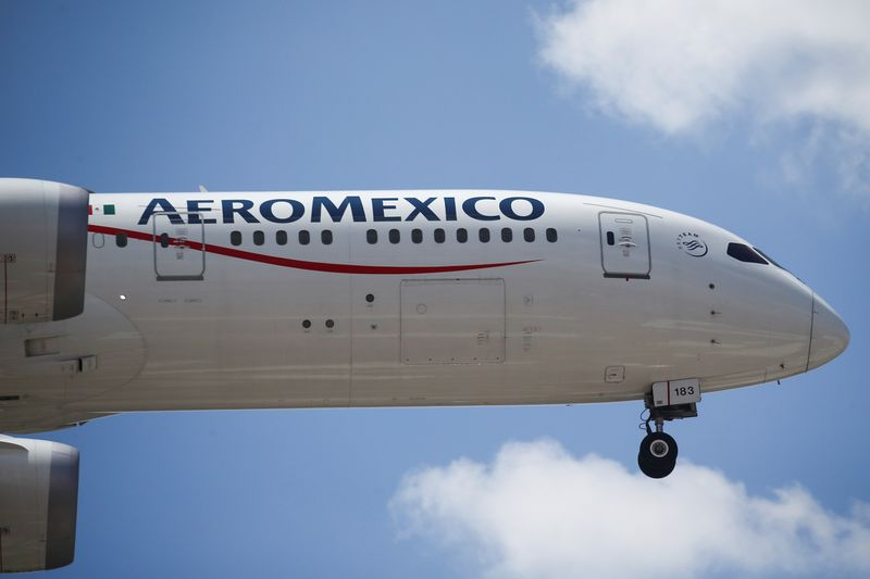 An Aeromexico airplane prepares to land on the airstrip at Benito Juarez international airport in Mexico City