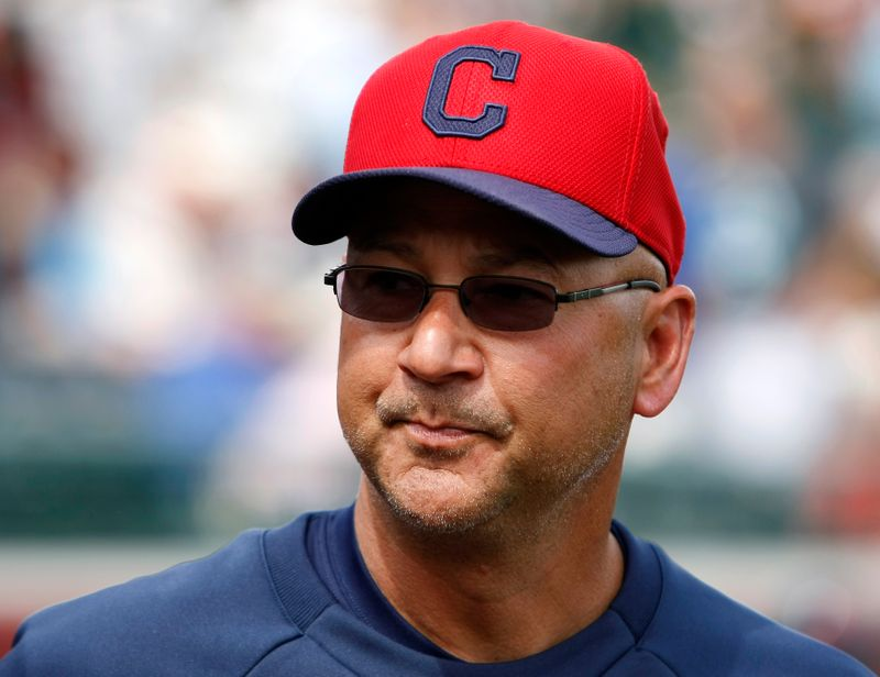 Indians' Terry Francona looks on during their MLB Cactus League spring training baseball game against the Giants in Scottsdale