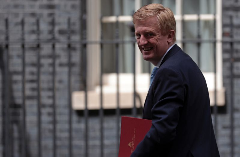 Britain's Secretary of State for Digital, Culture, Media and Sport Oliver Dowden walks outside Downing Street in London
