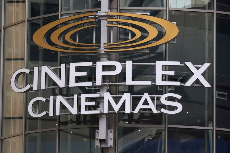 FILE PHOTO: A Cineplex movie theatre sign looms over Yonge street in Toronto