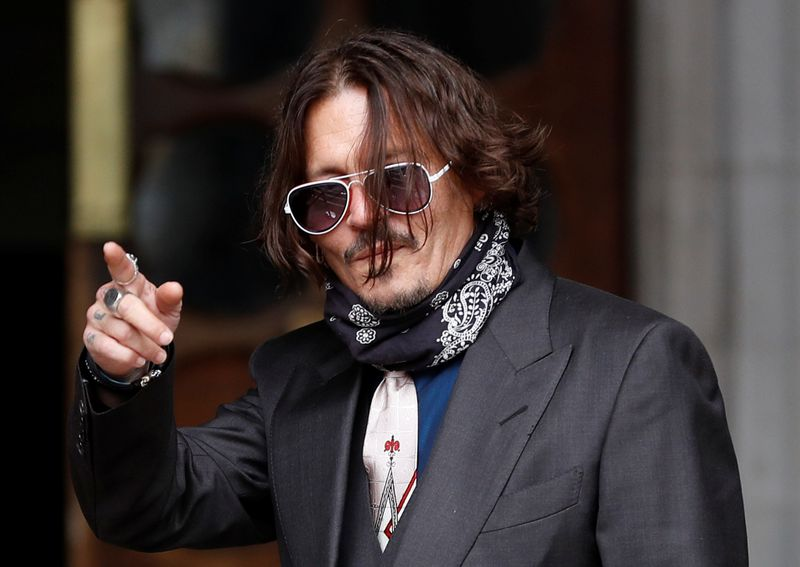 Johnny Depp denies slapping ex-wife for laughing at his tattoos