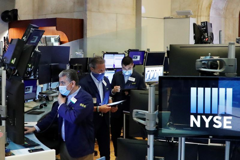 Wall St slips after strong recent rally, as COVID cases mount