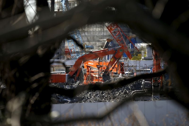 FILE PHOTO: Heavy machinery are seen at a construction site in Tokyo
