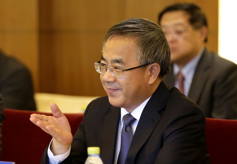 Chinese Vice Premier Hu Chunhua attends a meeting with Britain's Chancellor of the Exchequer Philip Hammond in Beijing