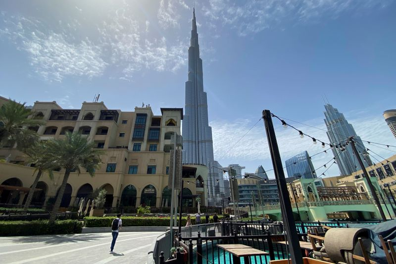 FILE PHOTO: People walk outside Dubai mall after the UAE government eased a curfew and allowed stores to open, following the outbreak of the coronavirus disease (COVID-19) in Dubai
