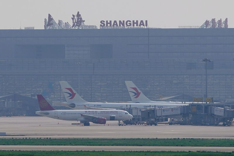 China Eastern Airlines aircraft are seen parked on the tarmac in Hongqiao International Airport in Shanghai