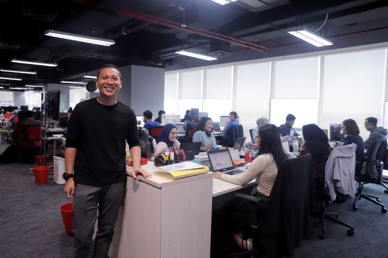 CEO of Indonesian e-commerce startup Bukalapak, Rachmat Kaimuddin, poses for a photo at their headquarters in Jakarta