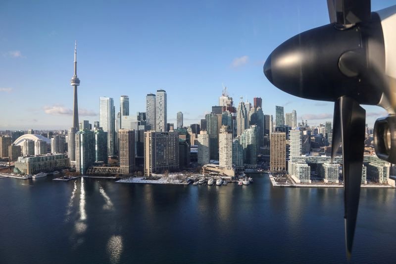 FILE PHOTO: The landmark CN Tower and downtown core are seen on the waterfront from a landing commuter plane in Toronto