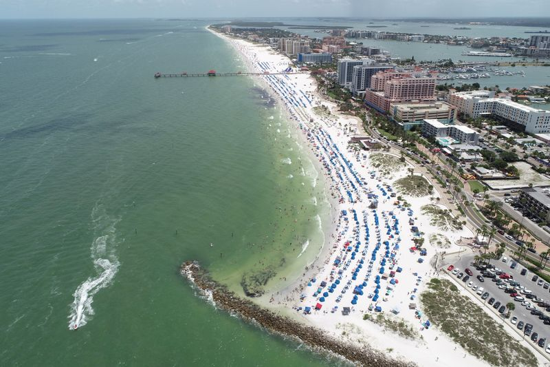 Sun seekers gather at Clearwater Beach on Independence Day