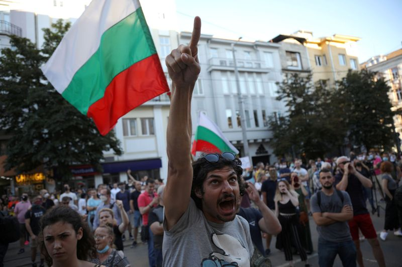 FILE PHOTO: People take part in a demonstration after prosecutors raided Bulgarian president's offices as part of investigations in Sofia