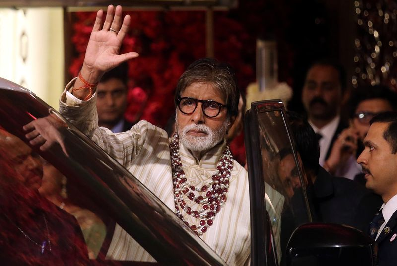 Bollywood actor Amitabh Bachchan leaves after attending the wedding ceremony of Isha Ambani in Mumbai
