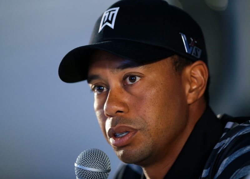 U.S. golfer Woods speaks during a news conference at the Farmers Insurance Open in San Diego