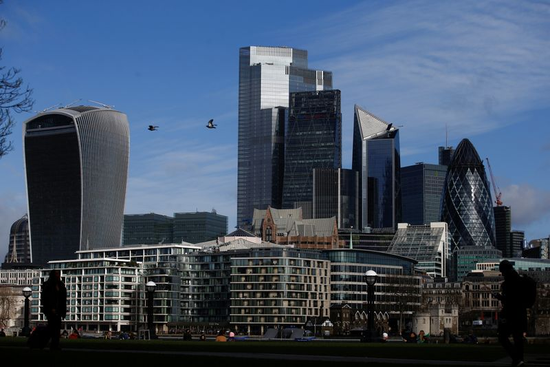 City of London financial district can be seen, whilst British stocks tumble as investors fear that the coronavirus outbreak could stall the global economy, in London