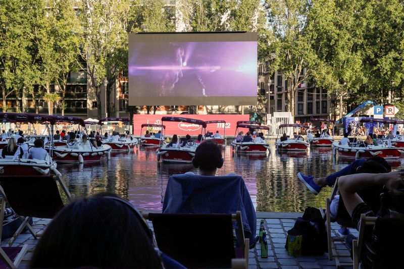 Floating cinema with socially-distant electric boats in Paris