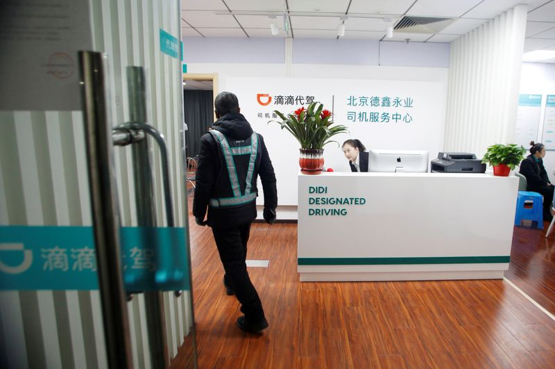 FILE PHOTO: Substitute driver arrives for a training session at Didi Chuxing's Designated Driving office in Beijing