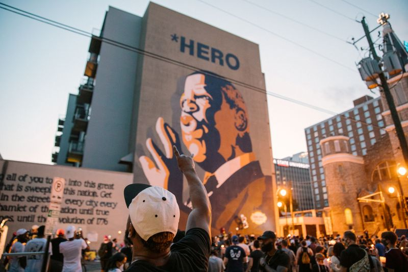 FILE PHOTO: Mourners of the late Rep. John Lewis hold a vigil in his memory in Atlanta