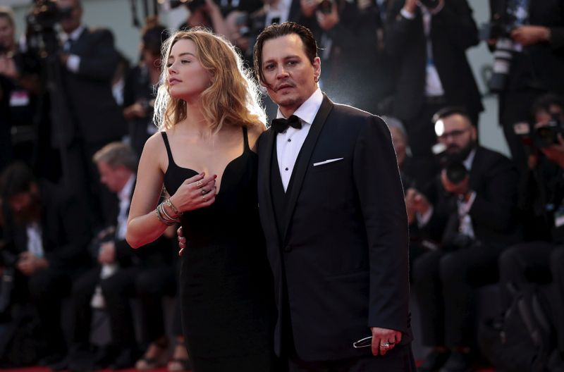 FILE PHOTO: Actor Depp and his wife Heard attend the red carpet event for the movie