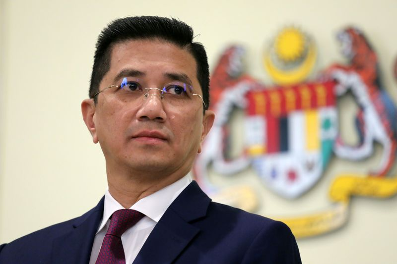 FILE PHOTO: Malaysia's Minister of International Trade and Industry Azmin Ali reacts during a news conference in Putrajaya