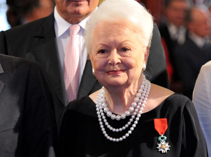 FILE PHOTO: Actress Olivia de Havilland looks on after she was awarded with the Legion d'honneur at the Elysee Palace, France