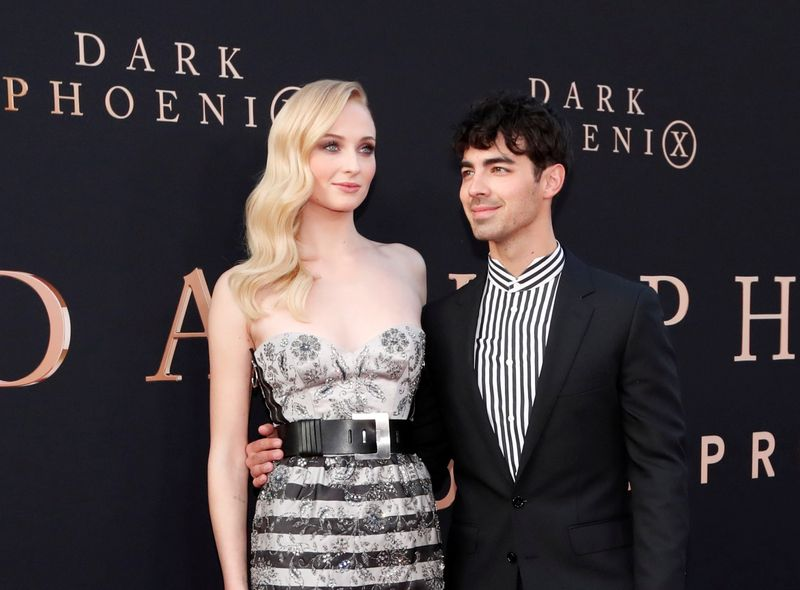 FILE PHOTO: Actor Sophie Turner poses with her husband Joe Jonas at the premiere for the film