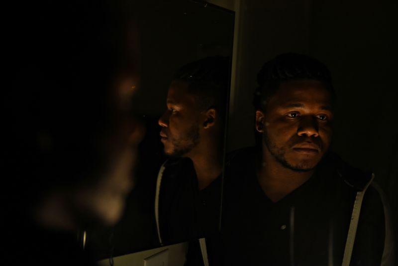 Tristan Jackson-Stankunas poses for a portrait at his apartment in Austinu000d