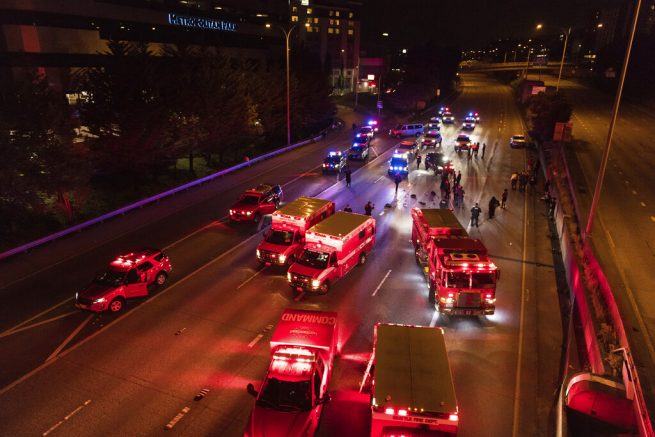 1 of 2 protesters hit by motorist on closed Seattle highway dies