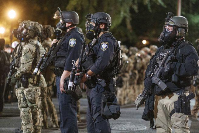Portland protesters surround police precinct