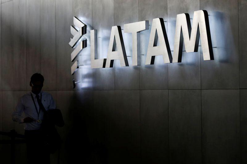 LATAM airlines logo, is seen inside of the Commodore Arturo Merino Benitez International Airport in Santiago