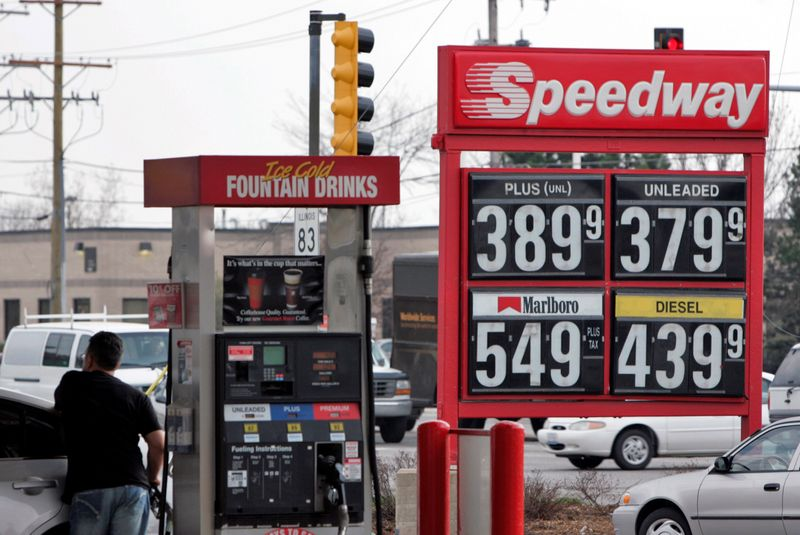 FILE PHOTO: Robert Giatras fuels-up his car at a Speedway gas station in Des Plaines, Illinois