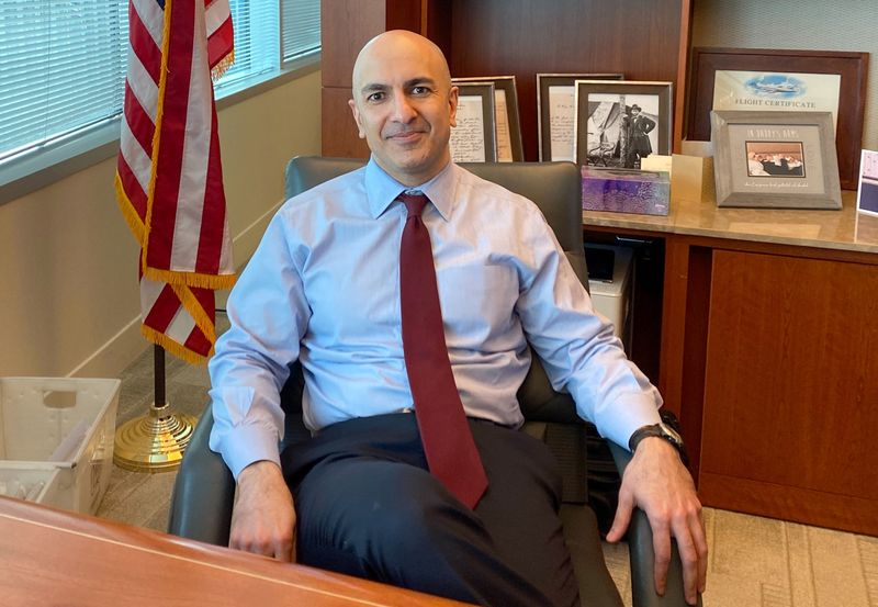 Minneapolis Federal Reserve Bank President Neel Kashkari poses during an interview with Reuters in his office at the bank's headquarters in Minneapolis